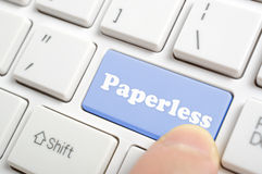 Pressing paperless key on keyboard. Pressing blue paperless key on keyboard Stock Photography