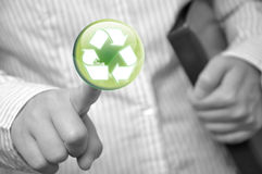 Pressing recycle sign button. Business woman pressing recycle sign button Stock Photography