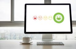 Pressing smiley face emoticon The Customer Service Target Business Customer review give a five star royalty free stock photos