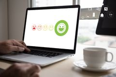 Pressing smiley face emoticon The Customer Service Target Business Customer review give a five star stock photos