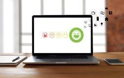 pressing smiley face emoticon The Customer Service Target Busine Royalty Free Stock Image