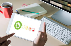 pressing smiley face emoticon The Customer Service Target Busine Stock Image