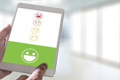 pressing smiley face emoticon The Customer Service Target Busine Royalty Free Stock Photos