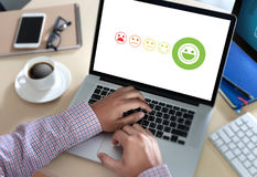 pressing smiley face emoticon The Customer Service Target Busine Royalty Free Stock Photo