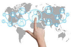 Pressing social media icon. Woman hand pressing social media icon on white background with world map Stock Photography