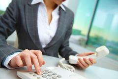 Pressing telephone buttons Stock Images