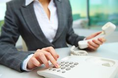 Pressing telephone buttons Stock Image