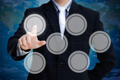 Pressing on touch screen. Hand of businessman pressing on a touch screen interface Stock Image
