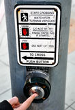 Pressing traffic light button Stock Photos
