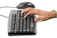 Pressionando a chave do entre no teclado de computador Imagem de Stock