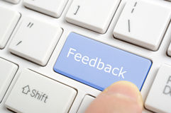 Pressionando a chave do feedback Fotos de Stock