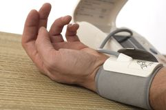 Pressure. Close up of a hand measuring blood pressure Royalty Free Stock Photo