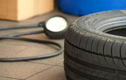 Pressure. And inflate a tyre Royalty Free Stock Photography