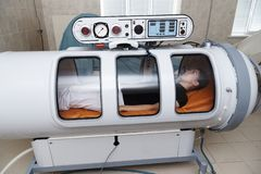 A pressure chamber. A pressure chamber is a device that saturates the body with a significant amount of oxygen. Hyperbaric oxygenation stock photography