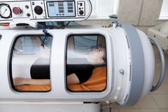 A pressure chamber is a device that saturates the body with a significant amount of oxygen. Hyperbaric oxygenation stock photo