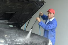 Pressure cleaning vehicles boot Royalty Free Stock Photos