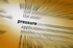 Pressure. 1: the continuous physical force exerted on or against an object by something in contact with it. 2: the use of persuasion, influence, or Royalty Free Stock Images