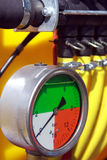 Pressure control. Pressure measuring device and yellow hoses Stock Photography