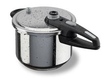 Pressure cooker. Shining pressure cooker with the black handle Royalty Free Stock Photo