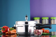 Pressure cooker. A pressure cooker in a kitchen ambiance Stock Photos
