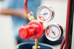 The pressure gage and valve on lpg tank. Royalty Free Stock Images