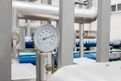 The pressure gage in water cold pipe on big air condition system.  stock photos