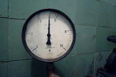 Pressure gauge. A pressure gauge dial reading 5 Stock Photo