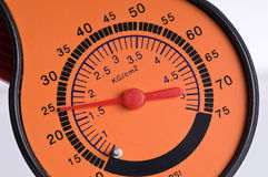 Pressure gauge. Closeup orange red Pressure gauge Royalty Free Stock Image