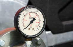 Pressure gauge. On technical device Stock Photo