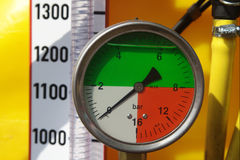 Pressure gauge. Division scale, yellow hose with clamp Stock Photo