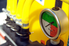 Pressure gauge. Silver pressure gauge with coloured scale Stock Photos