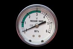 Pressure gauge. Indicator isolated on black Stock Photo