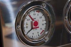 Pressure gauge. Aluminium pressure gauge on cappuccino maker Royalty Free Stock Image