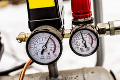 The pressure gauge on the air compressor half full Stock Photos