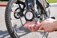 The pressure gauge of the compressor. Shows the air pressure being pumped into the Bicycle wheel. stock image