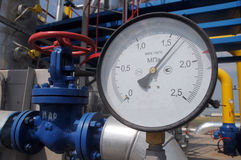 Pressure gauge at the gas compressor station. The pressure gauge is on the gas compressor station in a sunny summer day royalty free stock image