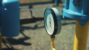 Pressure gauge on a gas pipe. Pipeline at the oil and gas station. Production of fuel. A station for purification and stock footage