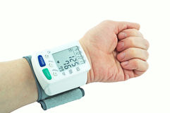 The pressure gauge on hand. Instrument for measuring blood pressure on your hand Royalty Free Stock Images