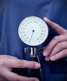 Pressure gauge in the hands of a doctor Stock Photos