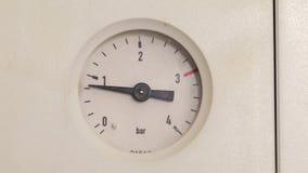 Pressure gauge of a heating system. Manometer of a heating system when filling up with water stock video footage
