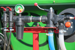 Pressure gauge manometer. On green Stock Photo