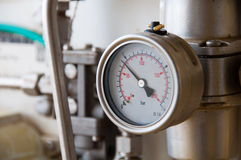 Pressure gauge for measuring pressure in the system, Oil and gas process used pressure gauge to monitor pressure condition inside. Royalty Free Stock Images