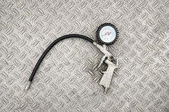 Pressure gauge on metallic background Royalty Free Stock Photo