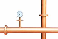 Pressure gauge meter installed on copper pipes Royalty Free Stock Photo