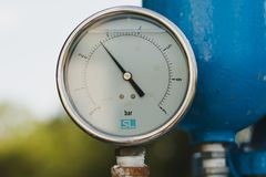 A pressure gauge with oil. stock image