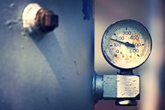 Pressure gauge. Old rusty pressure gauge on a tank Royalty Free Stock Image