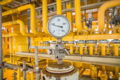 Pressure gauge with pipe line and process flow line. Stock Image