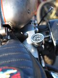 Important readings. The pressure gauge removed to the seat of the old motorcycle. Analog measurement devices Stock Image