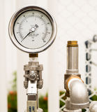 Pressure gauge and safety release valve in gas supply system. Pressure gauge and safety release valve in outdoor gas supply system Royalty Free Stock Photo