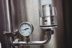 Pressure gauge on storage tank in brewery Royalty Free Stock Images
